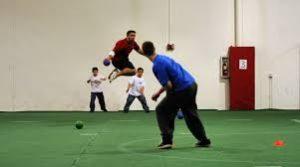Two men playing an intense game of dodgeball