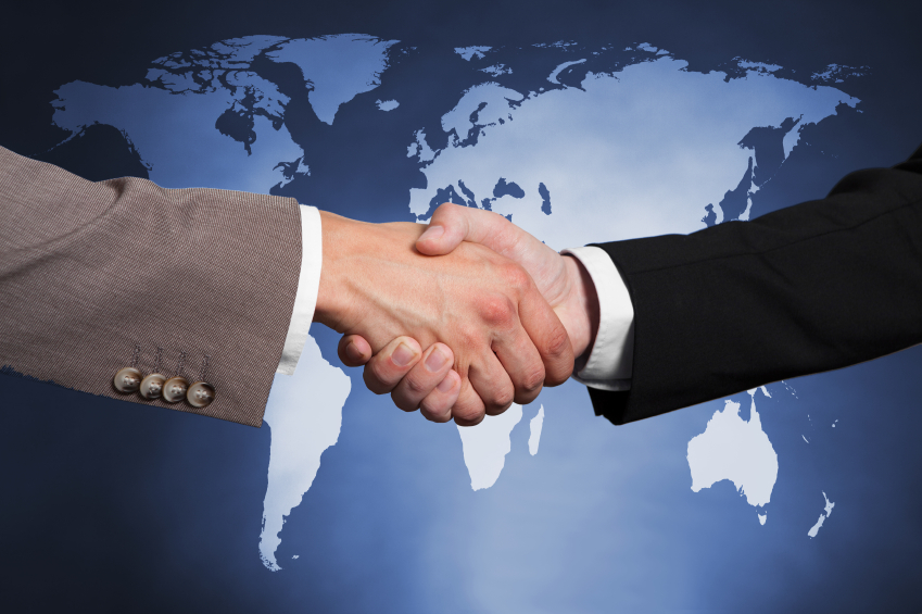 image of businessmen shaking hands against worldmap.