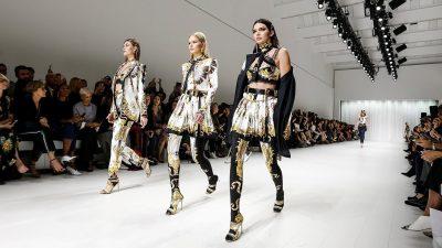 Three fashion models on the runway