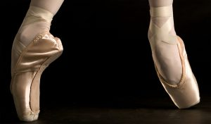 Pointe shoes that ballerinas use.