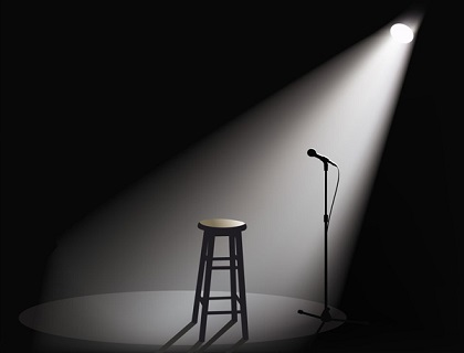 Open mic and a chair and spotlight