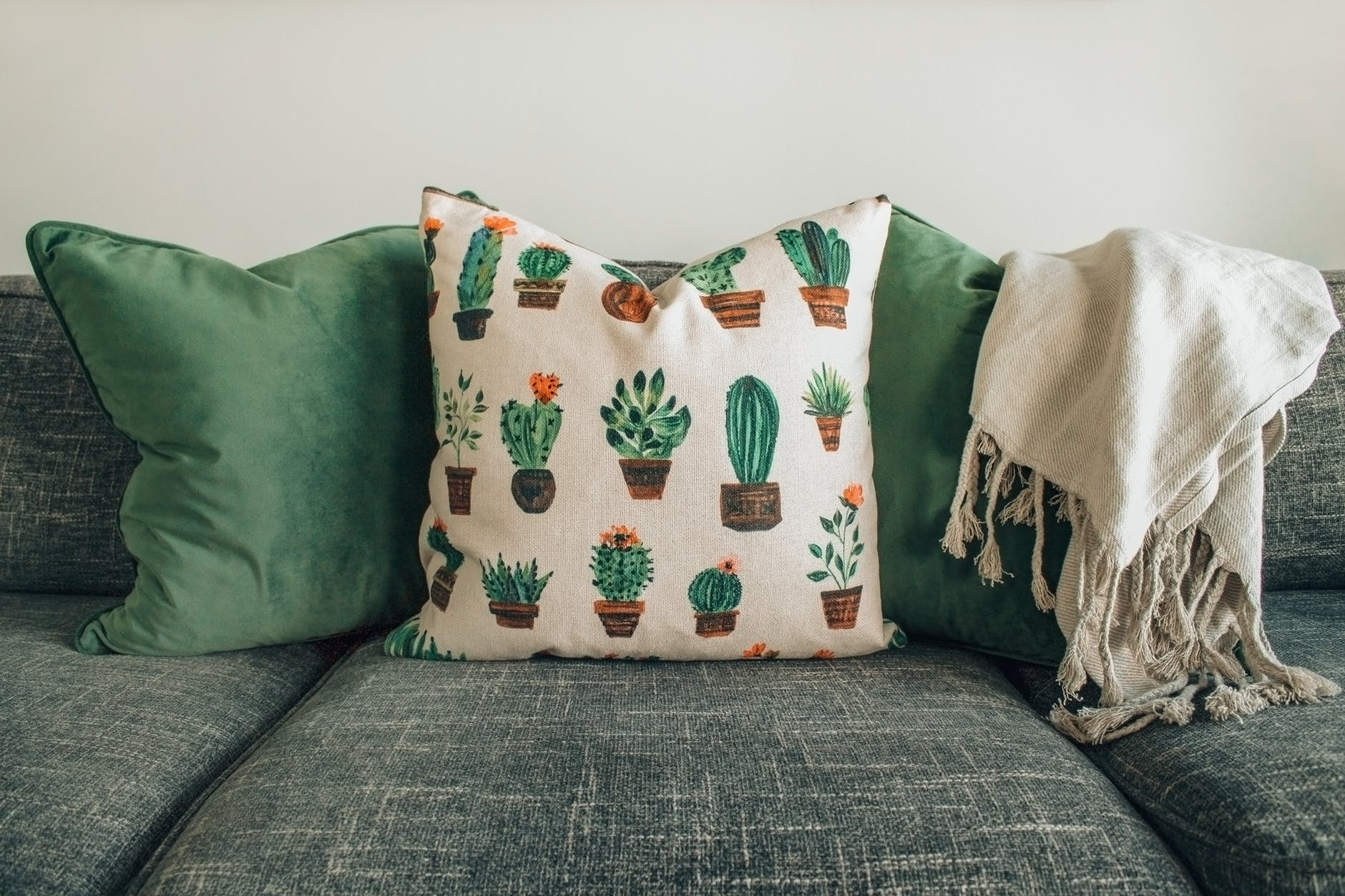 Decorative pillows and sheet on couch
