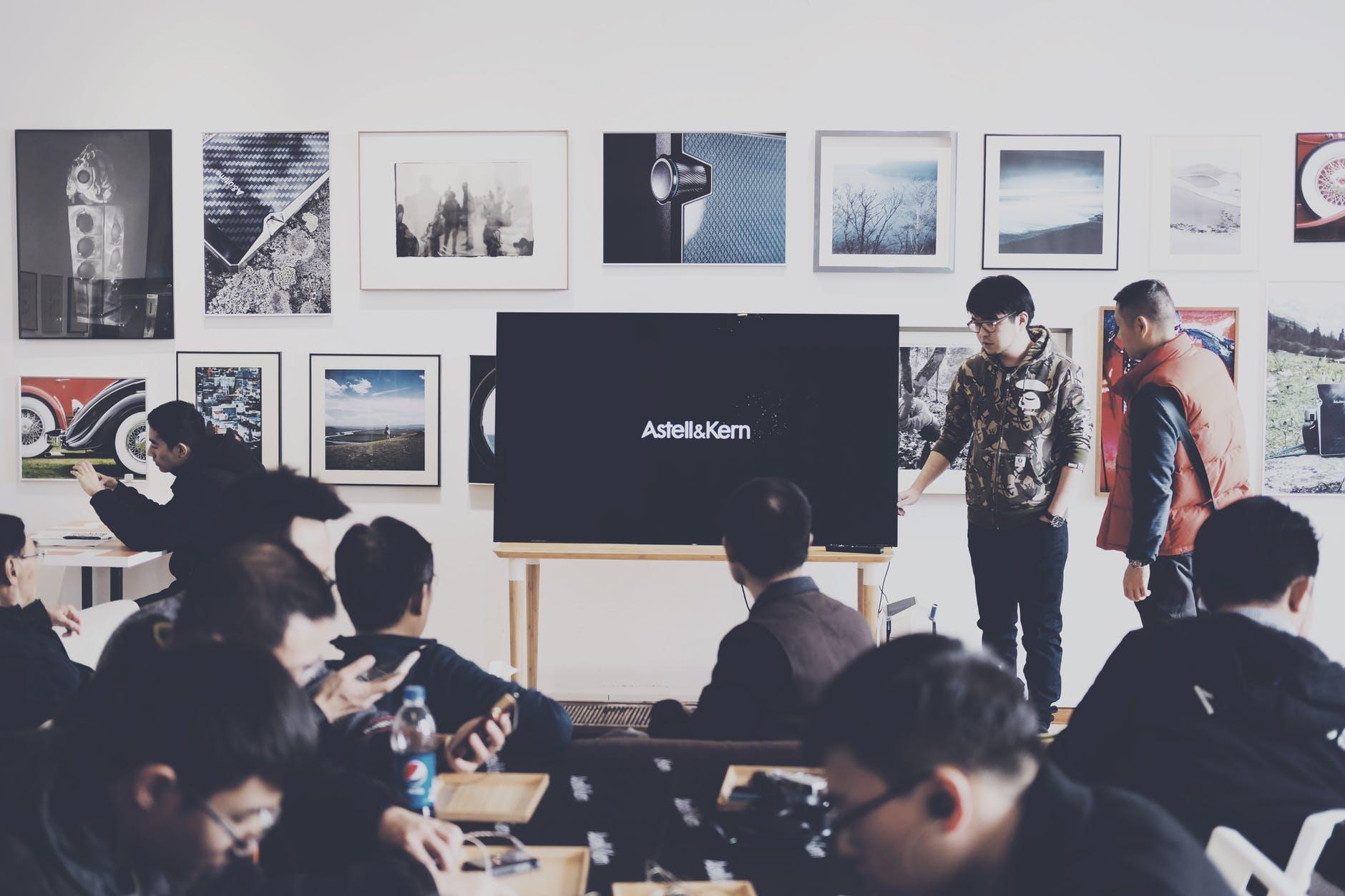 group of people in art exhibit