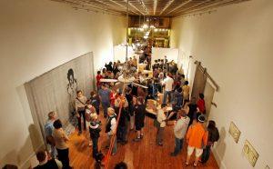 Locals of Richmond mill around an art gallery on First Friday.