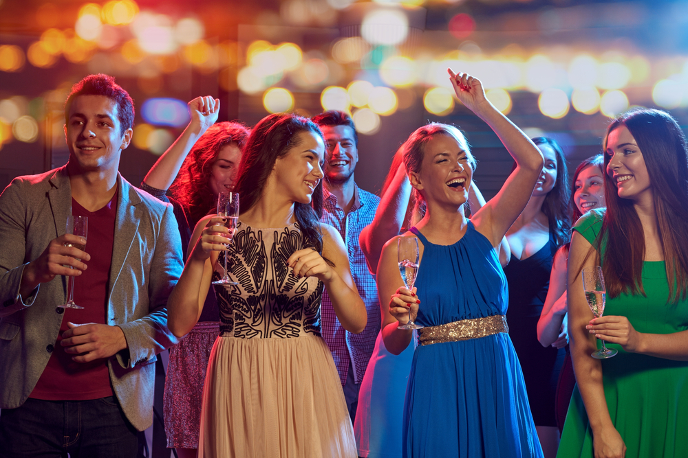 young people in formal wear at a party