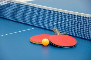 An image of paddles in table tennis.=