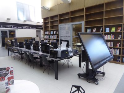 Rows and rows of computer units at the library