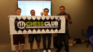 Some members of the chess club showing off their club spirit!