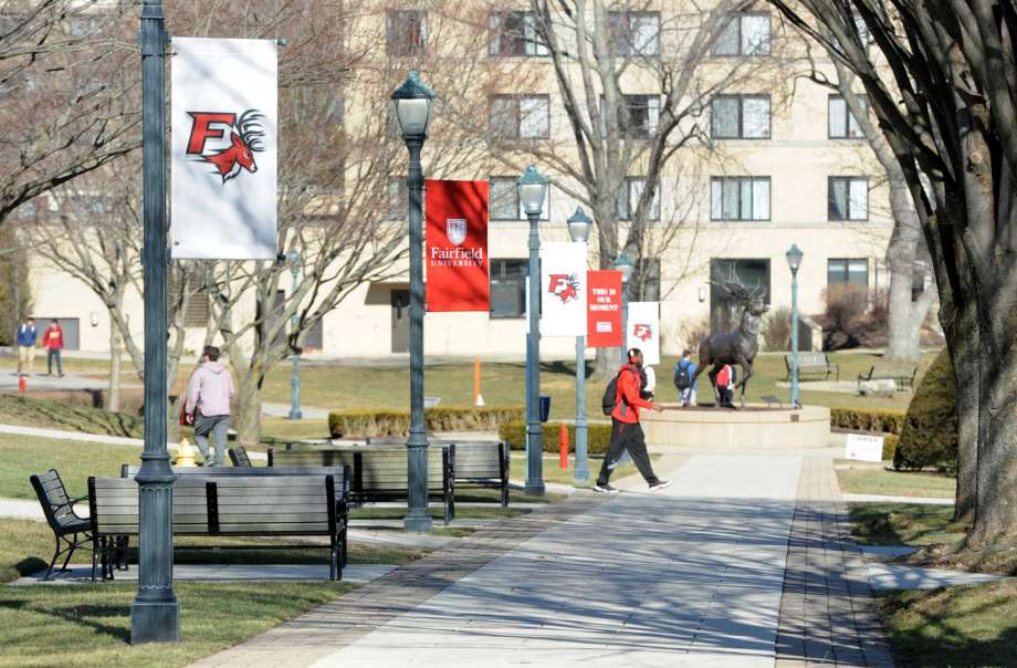 Fairfield University campus walkaway with banners of the university
