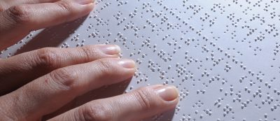 Blind person and his braille sheet