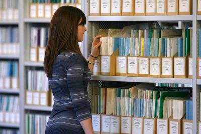 Female student browsing the library collection