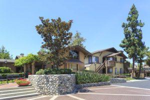 Tan house located in Woodbridge Pines
