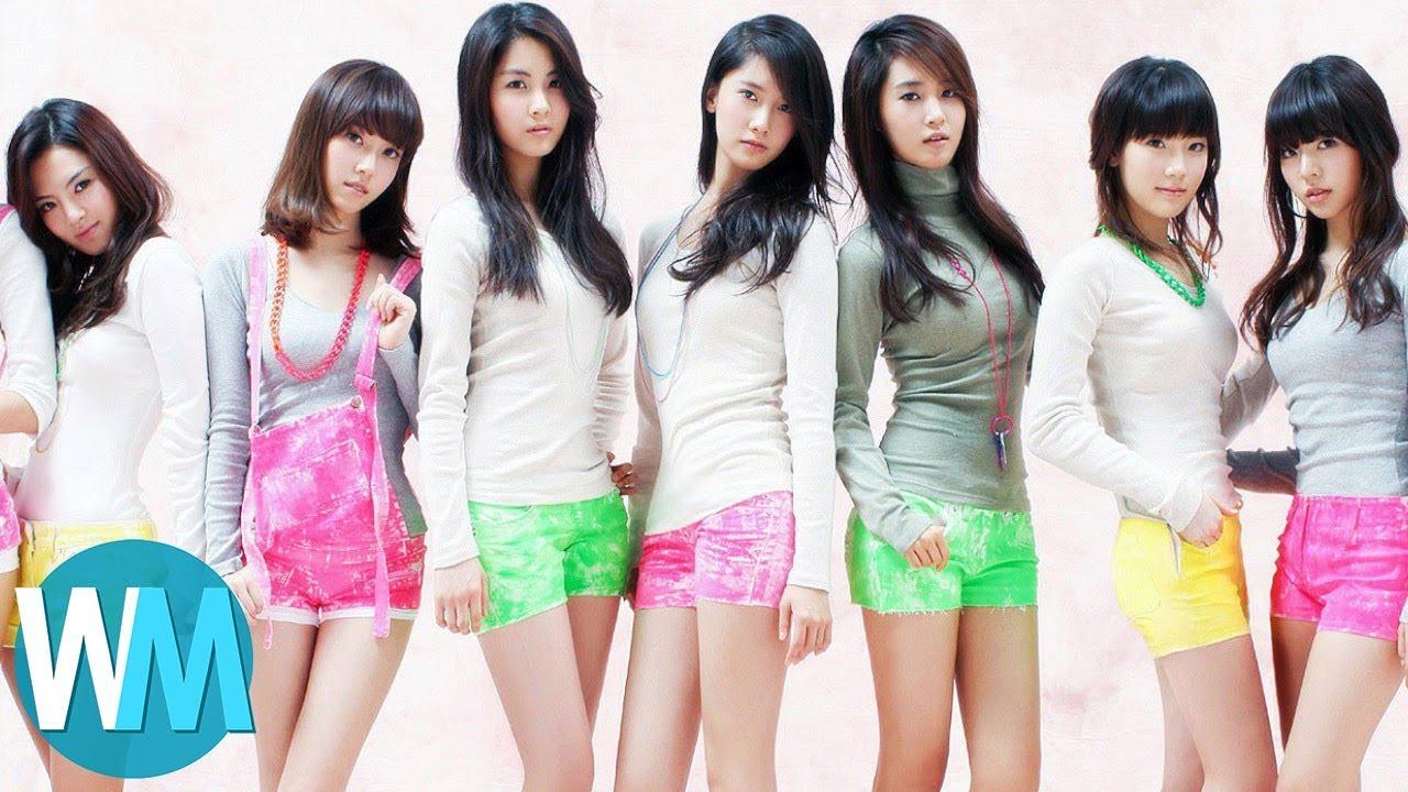a k pop group wearing matching shorts
