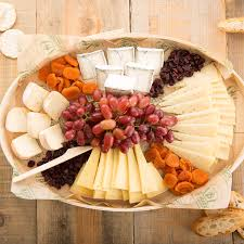a cheese platter with a variety of cheeses and snacks