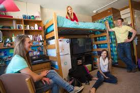 Everyone hanging out in the dorm room