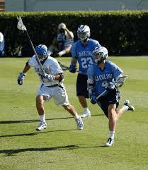 Men playing lacrosse.