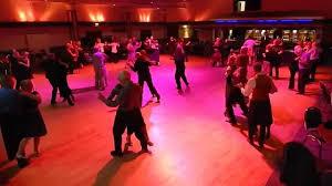 Couple Ballroom dancing in a dance room.