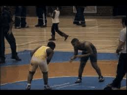 Some men wrestling.