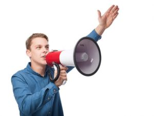A person saying something with a bullhorn