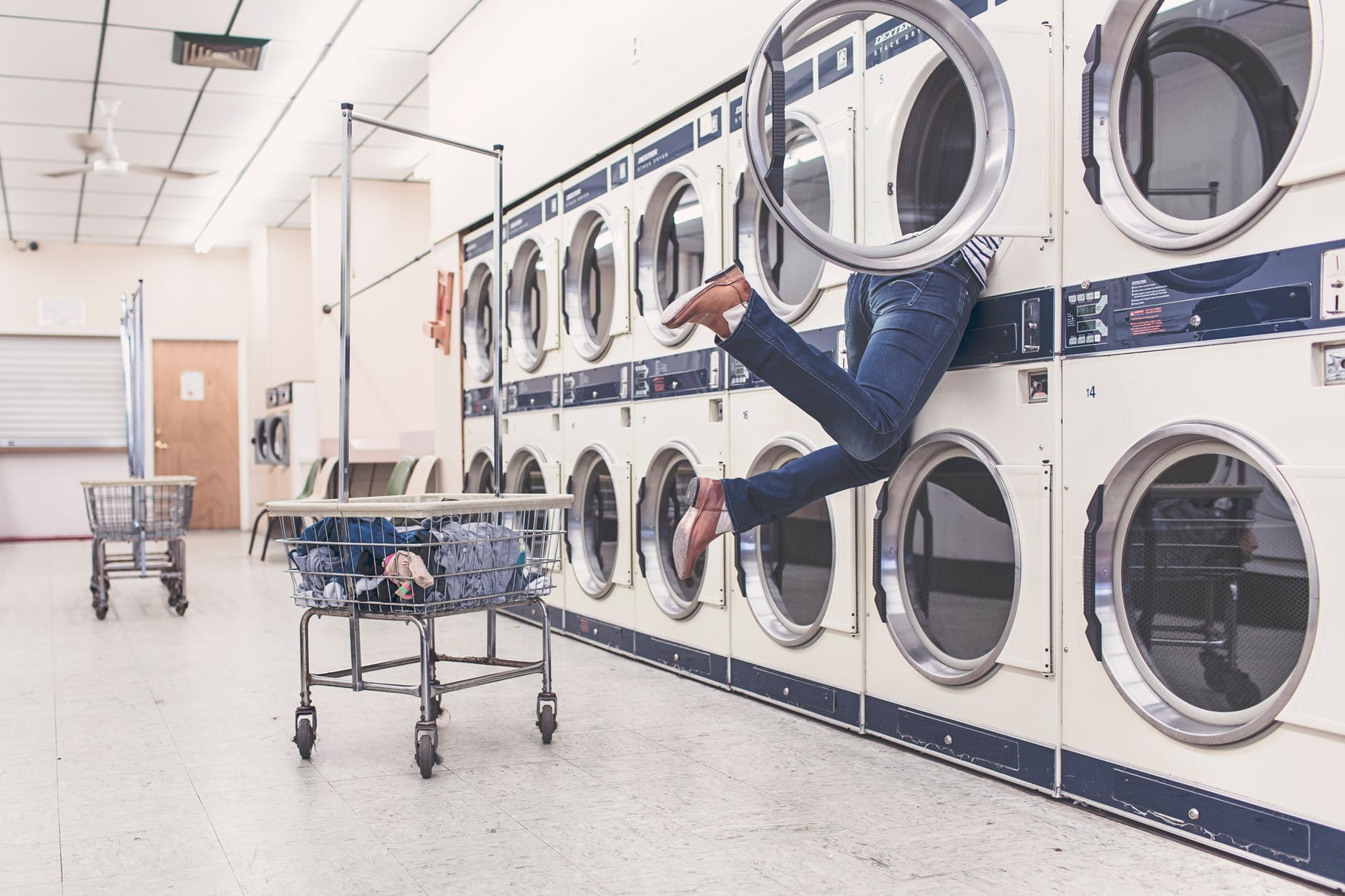 person searching for laundry in laundry room