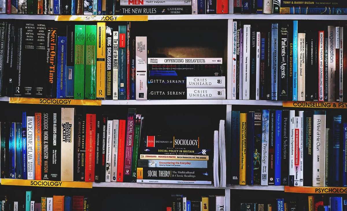 photography of books on bookshelf