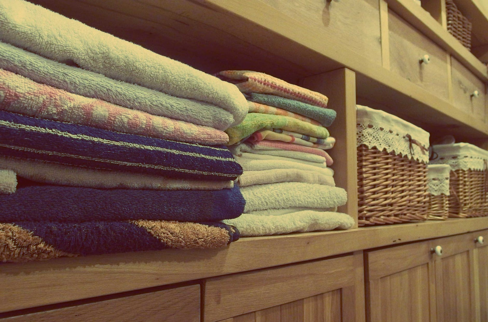 Folded towels on a shelf