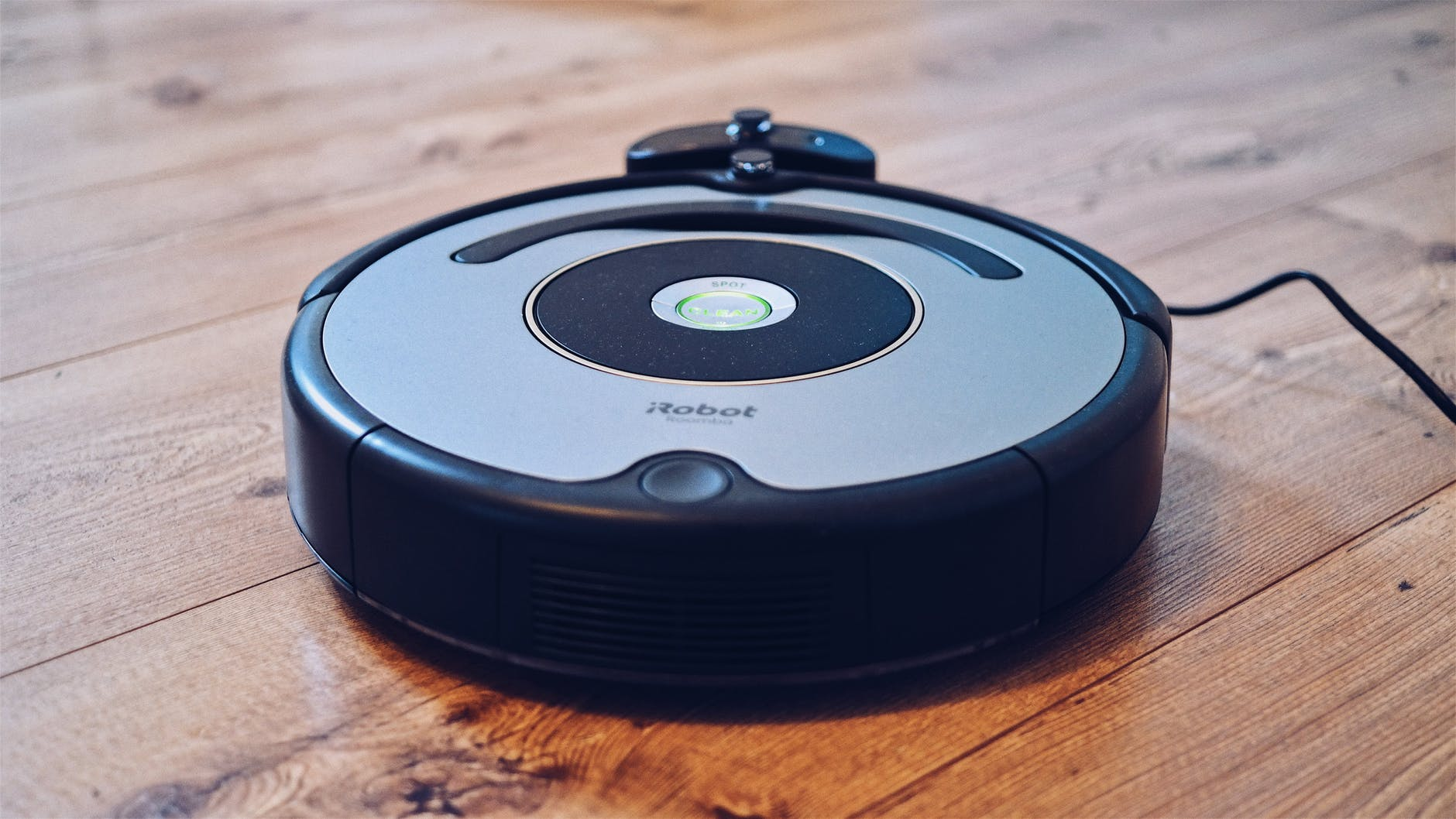 Roomba vacuum on hard wood floor