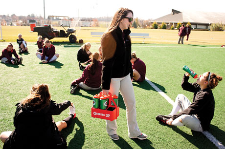 This image shows students participating in athletic training, utilizing skills learned in this club.