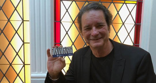 Writer David day holds a library community card.