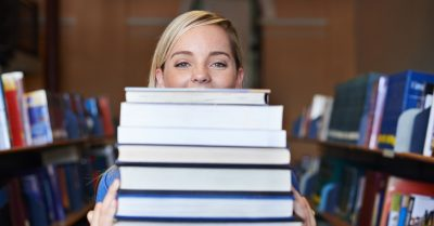 Woman checking out books from the library