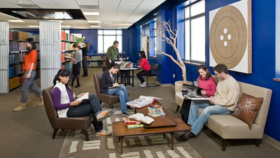 Students studying from the ACA Library study space