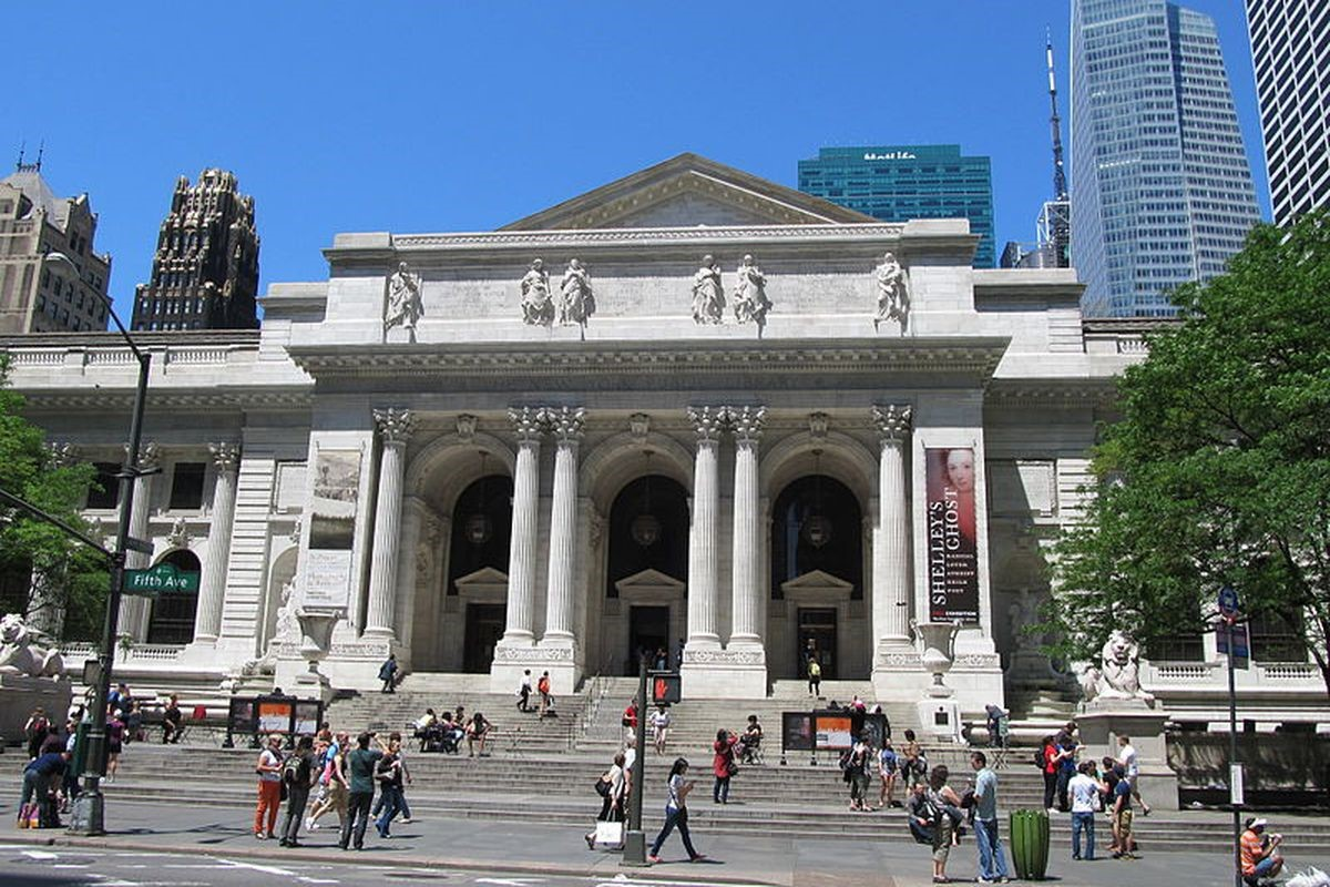Students playing in front of the New York Public Library