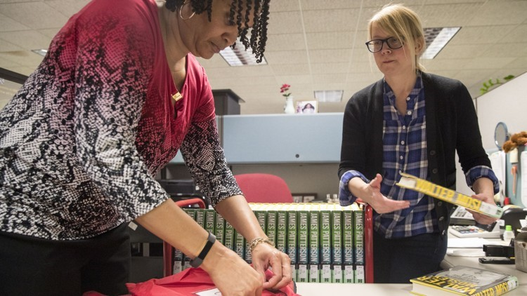 Staff at Metro Atlanta Library easing out some books