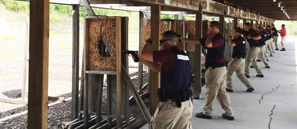 Security operatives practicing shooting