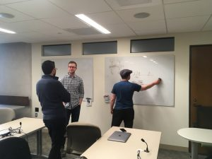 students discussing after AI class