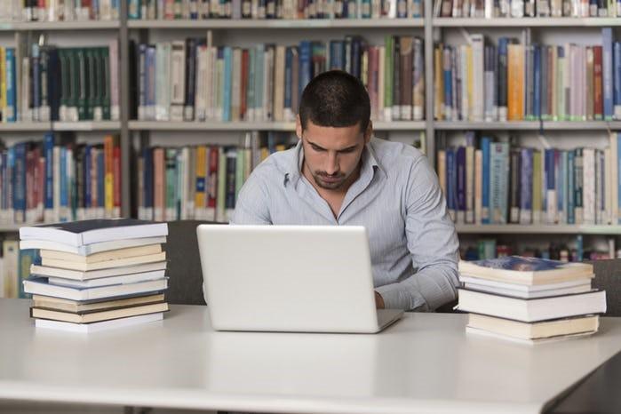Postgraduate undertaking an online course