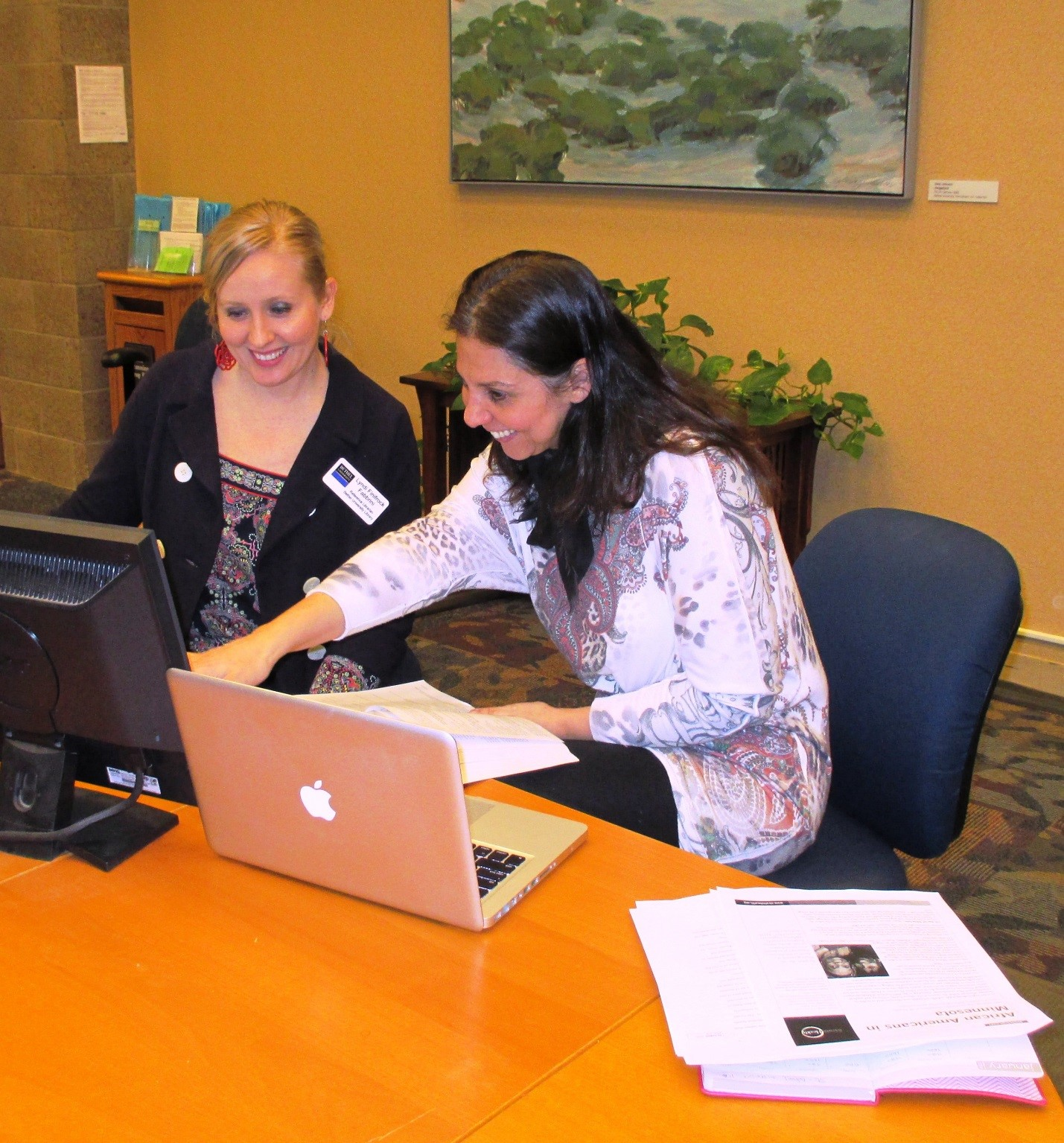 Two librarians doing mail work – Bethel Library