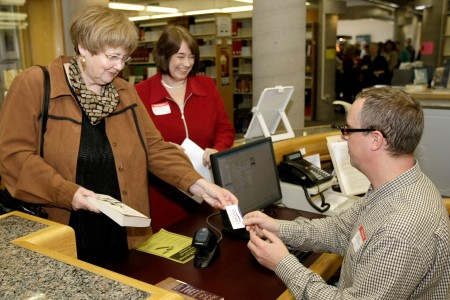 Library patrons borrowing books