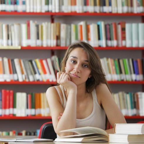 A student studying from the librar