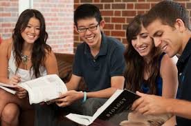 Students reading a Biology book borrowed from the library