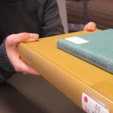 Close up of a hand holding a book