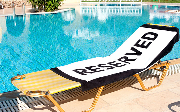 reserved sign on a pool chair