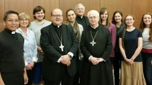 Members of the Catholic Students Association with the clergy