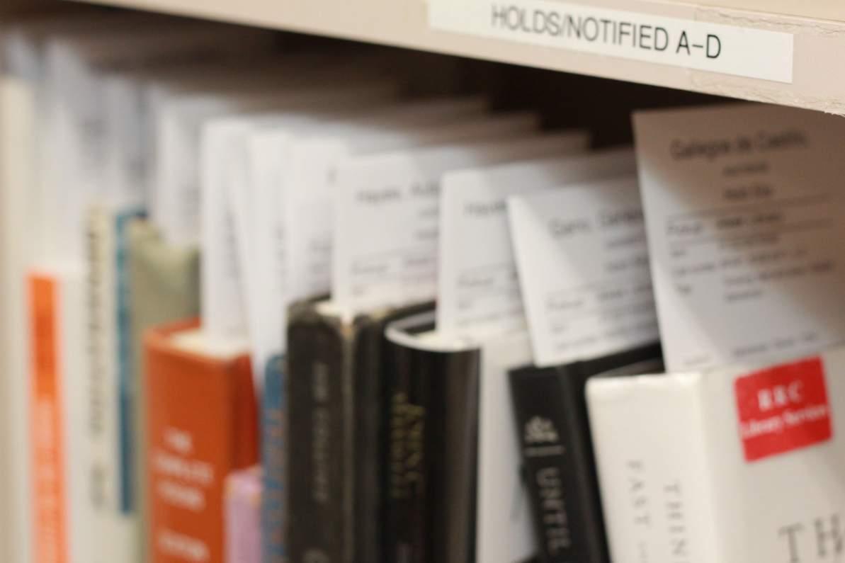 Books arranged in a shelf