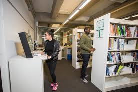 Student reserving courses at the library