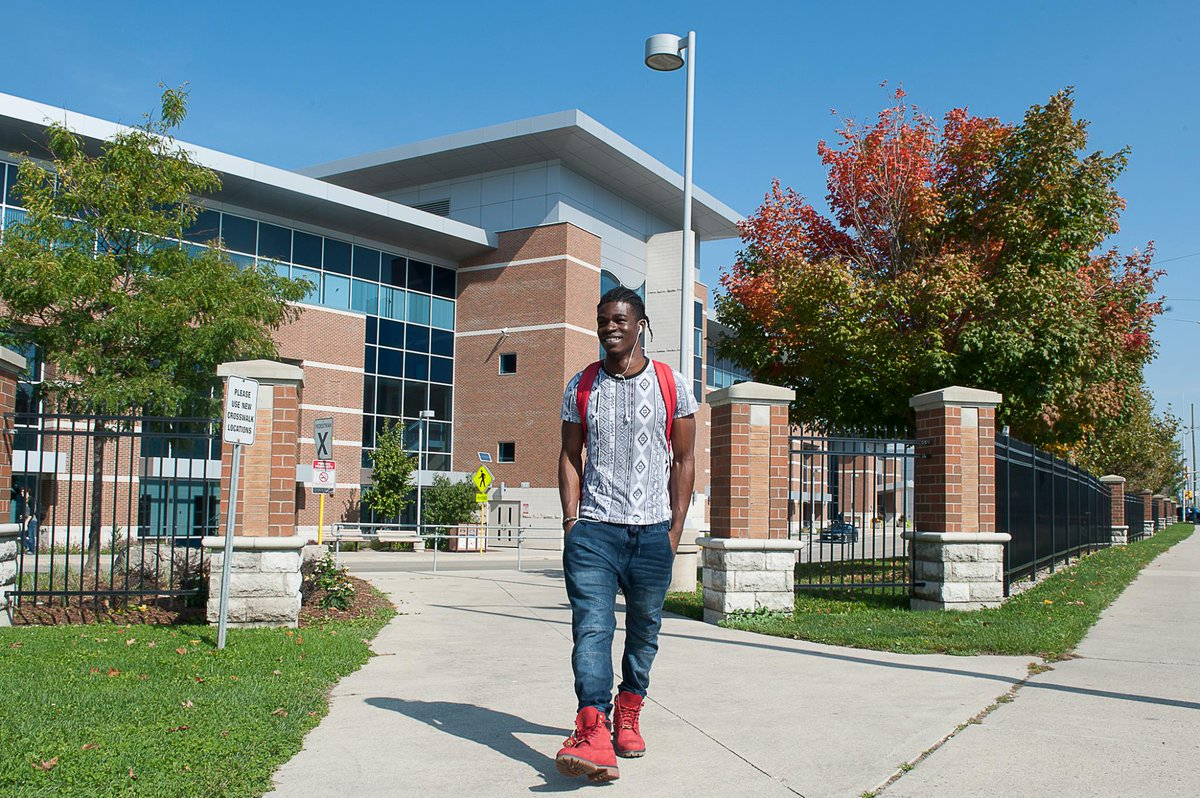 Student in front of Fanshawe College