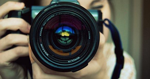 A person using a digital camera
