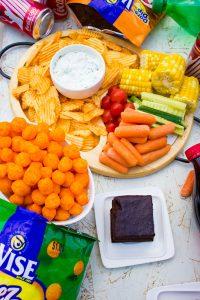 Chips, vegetables, brownie, corn