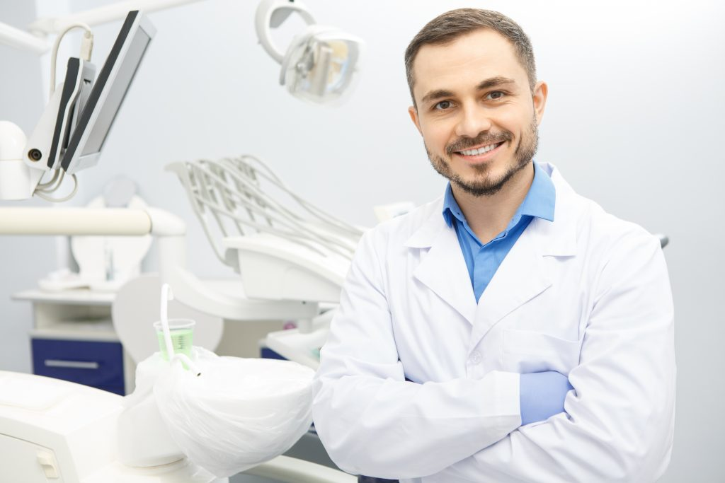 Image of Smiling Dentist Male