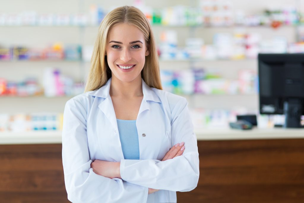 Image of a Smiling Female Pharmacist with her Arms Crossed